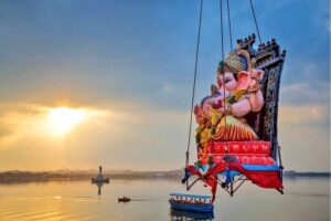 Ganesh idol lifted with crane for immersing in water